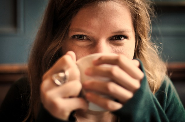 smiley woman with coffee